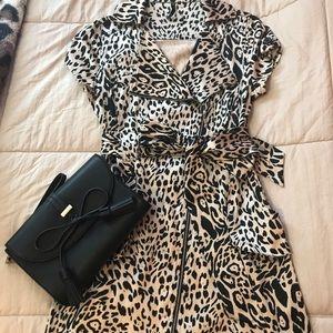 Short sleeve mini leopard zip up dress.